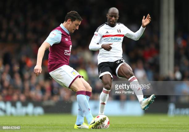 Tommy Elphick of Aston Villa and Sone Aluko of Fulham in action during the Sky Bet Championship match between Fulham and Aston Villa at Craven...