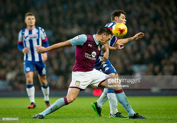 Tommy Elphick of Aston Villa ash challenged by Yanic Wildschut of Wigan Athletic during the Sky Bet Championship match between Aston Villa and Wigan...