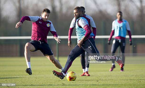 Tommy Elphick of Aston Villa in action with team mate Leandro Bacuna during an Aston Villa training session at the club's training ground at Bodymoor...