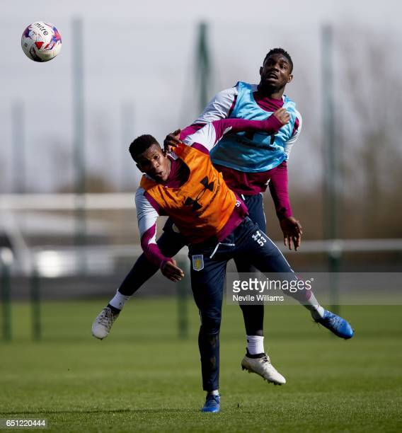Tommy Elphick of Aston Villa in action with team mate Ricardo Calder during a Aston Villa training session at the club's training ground at Bodymoor...
