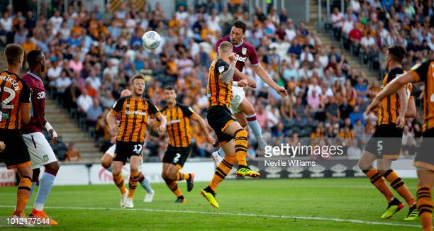 Tommy Elphick of Aston Villa scores for Aston Villa during the Sky Bet Championship match between Hull City and Aston Villa at KCOM Stadium on August...