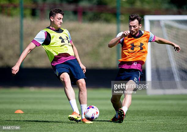Tommy Elphick of Aston Villa with team mate Libor Kozak in action during a Aston Villa training session at the club's training ground at Bodymoor...