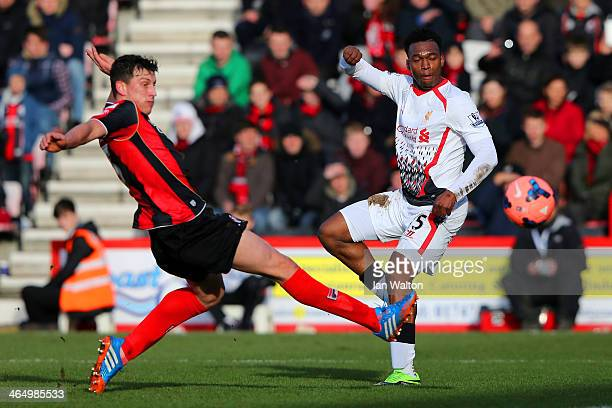 Tommy Elphick of Bournemouth and Daniel Sturridge of Liverpool compete for the ball during the FA Cup Fourth Round match between Bournemouth and...