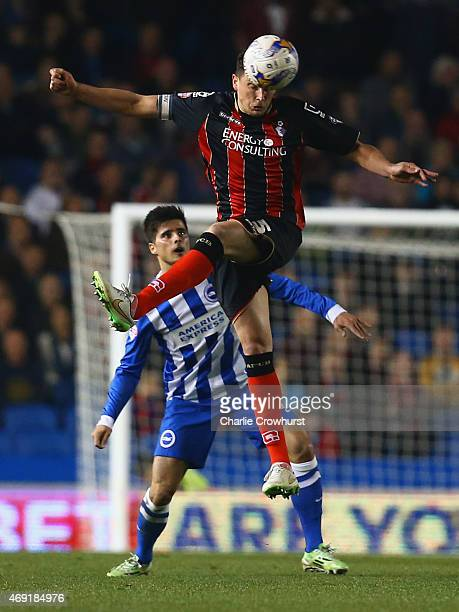 Tommy Elphick of Bournemouth beats Joao Carlos Teixeira of Brighton and Hove Albion to the ball during the Sky Bet Championship match between...