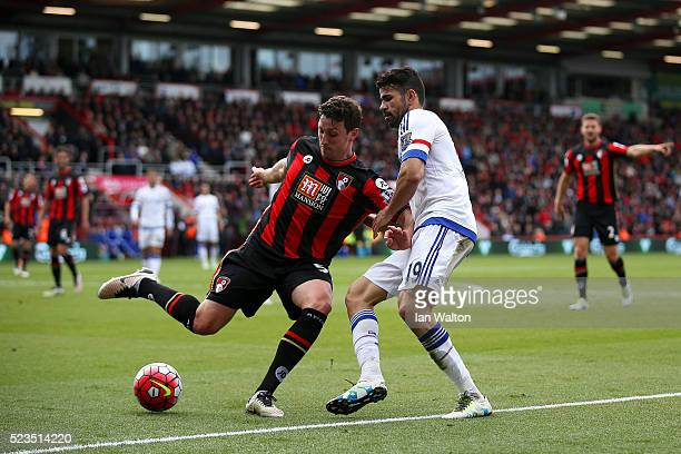 Tommy Elphick of Bournemouth clears the ball away from Diego Costa of Chelsea during the Barclays Premier League match between AFC Bournemouth and...