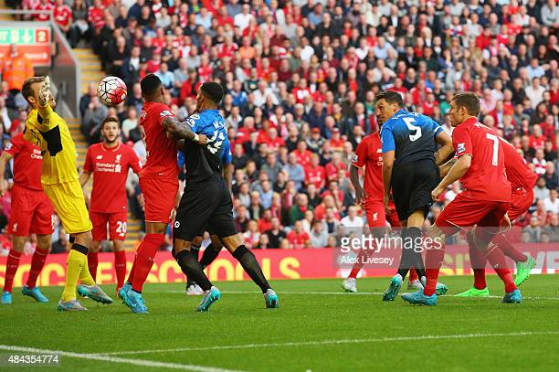 Tommy Elphick of Bournemouth heads the ball past goalkeeper Simon Mignolet of Liverpool but the goal is disallowed during the Barclays Premier League...