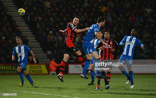 Tommy Elphick of Bournemouth heads wide during the FA Cup Third Round Replay between AFC Bournemouth and Wigan Athletic at Goldsands Stadium on...