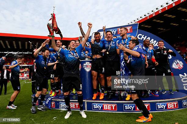 Tommy Elphick of Bournemouth lifts the trophy while Bournemouth players celebrate winning the Championship after the Sky Bet Championship match...