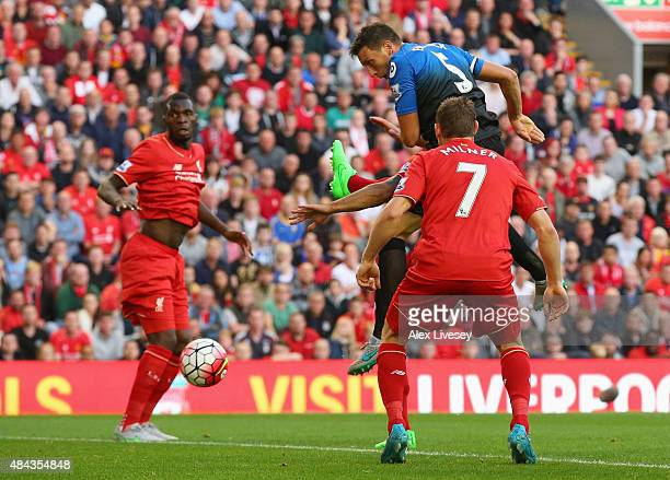 Tommy Elphick of Bournemouth scores but the goal is disallowed during the Barclays Premier League match between Liverpool and AFC Bournemouth at...