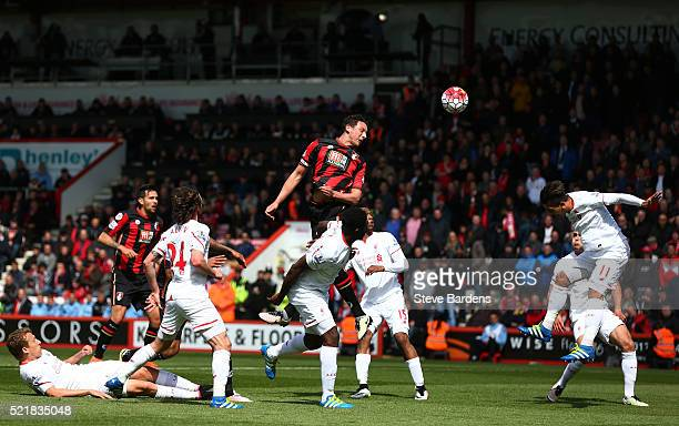 Tommy Elphick of Bournemouth wins a header during the Barclays Premier League match between AFC Bournemouth and Liverpool at the Vitality Stadium on...