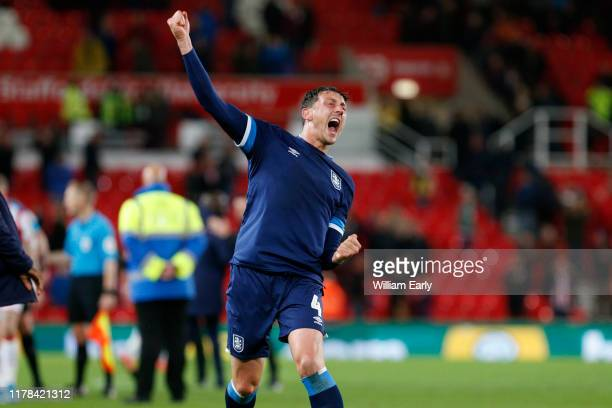 Tommy Elphick of Huddersfield Town celebrates during the Sky Bet Championship match between Stoke City and Huddersfield Town at Bet365 Stadium on...