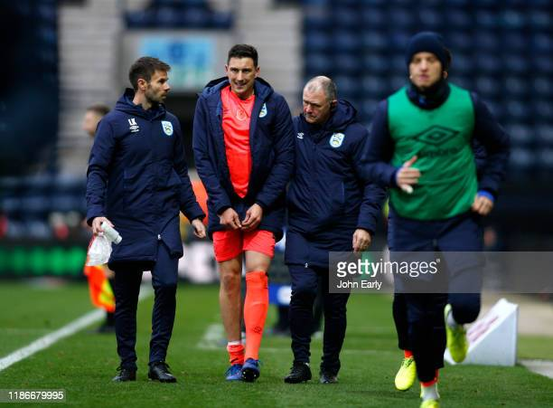 Tommy Elphick of Huddersfield Town leaves the pitch with an injury during the Sky Bet Championship match between Preston North End and Huddersfield...