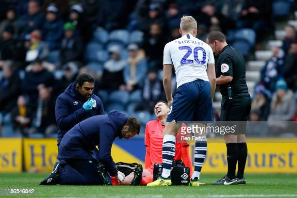 Tommy Elphick of Huddersfield Town receives treatment on the pitch during the Sky Bet Championship match between Preston North End and Huddersfield...
