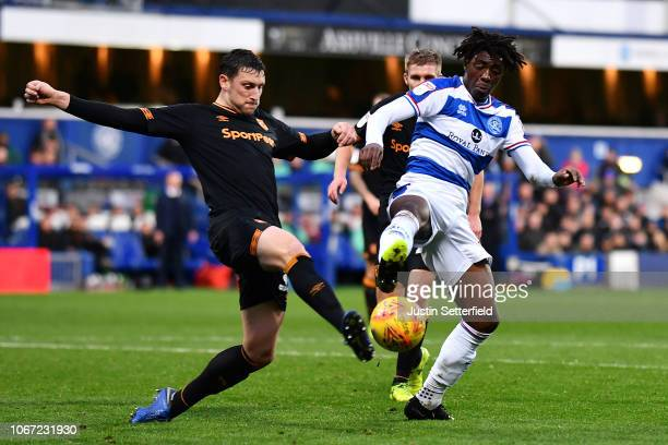 Tommy Elphick of Hull City clears from Eberechi Eze of Queens Park Rangers during the Sky Bet Championship match between Queens Park Rangers and Hull...