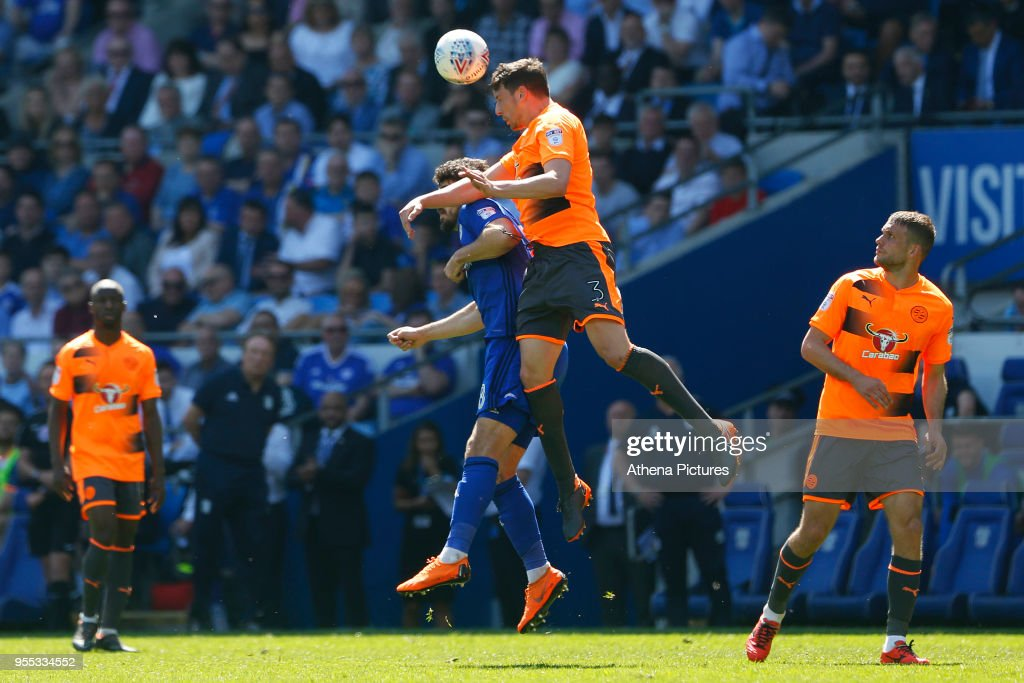 Tommy Elphick of Reading heads the ball away Callum Paterson