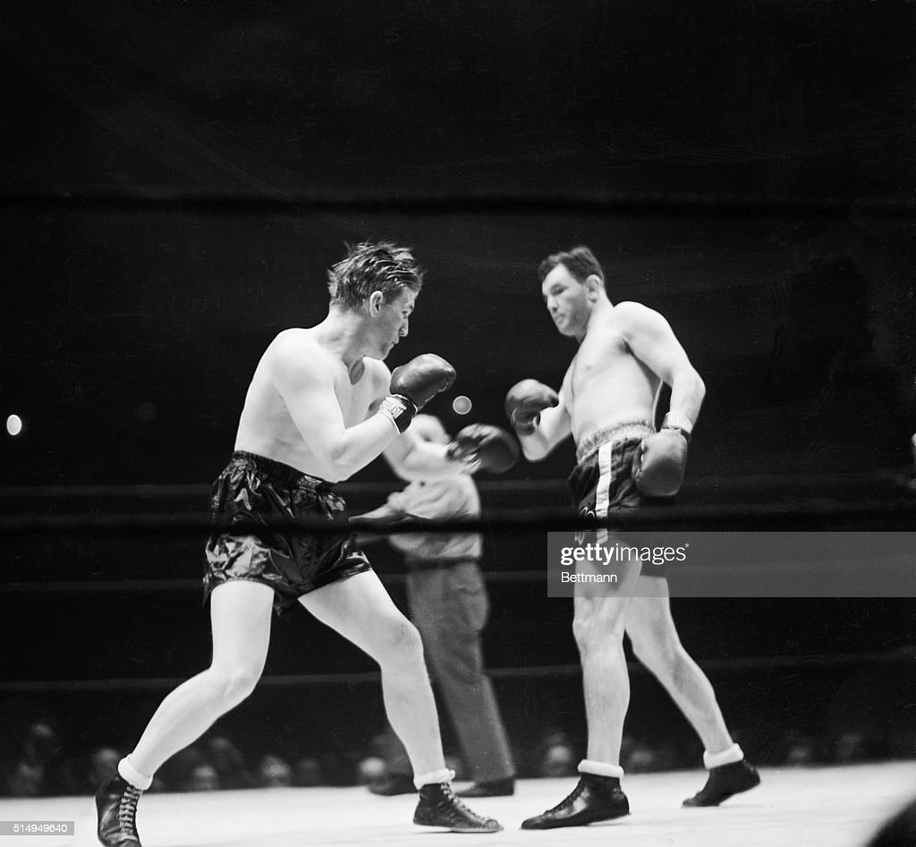 Tommy Farr (left) and Jimmy Braddock in the center of the ring each looking for an opening during their ten round bout in Madison Square Garden, January 21, 1938. A sustained rally in the last two rounds by Braddock proved the clincher that gave him the decision over Farr.