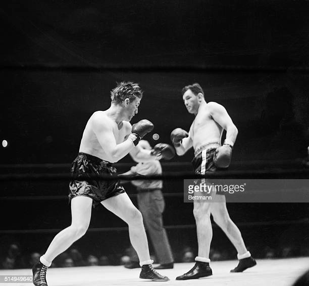 Tommy Farr and Jimmy Braddock in the center of the ring each looking for an opening during their ten round bout in Madison Square Garden January 21...