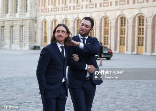Tommy Fleetwood and Jon Rahm of Team Europe walk in arm and arm to the Palace of Versailles for the Ryder Cup Gala dinner ahead of the 2018 Ryder Cup...