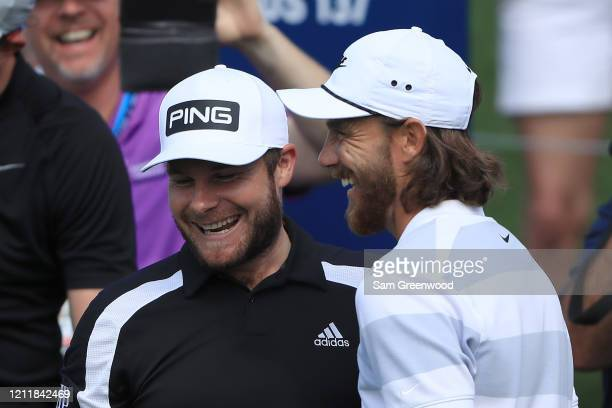 Tommy Fleetwood and Tyrrell Hatton of England talk during a practice round prior to The PLAYERS Championship on The Stadium Course at TPC Sawgrass on...