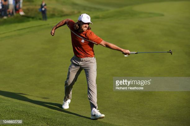 Tommy Fleetwood celebrates holing a putt to win the 12th during the afternoon foursome matches of the 2018 Ryder Cup at Le Golf National on September...