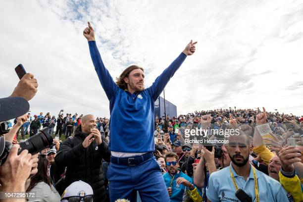 Tommy Fleetwood celebrates victory with the crowd after the singles matches of the 2018 Ryder Cup at Le Golf National on September 30, 2018 in Paris,...