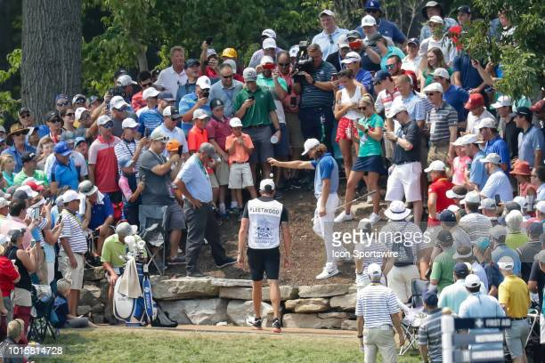 Tommy Fleetwood drops his ball in the crowd on the 11th hole during the PGA Championship August 12 at Bellerive Country Club in St Louis MO