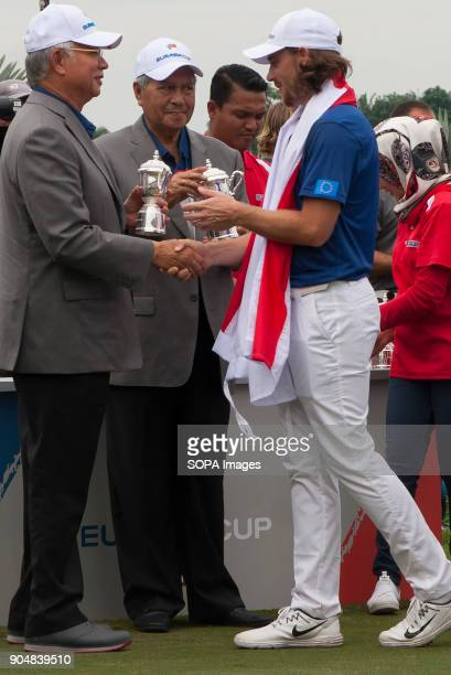 Tommy Fleetwood is seen receiving a ceremonial gift from the Malaysia Prime Minister Najib Razak EurAsia Cup is a biennial men professional team golf...
