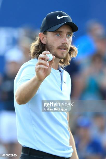 Tommy Fleetwood of England acknowledges the crowd on the 18th hole during the third round of the DP World Tour Championship at Jumeirah Golf Estates...