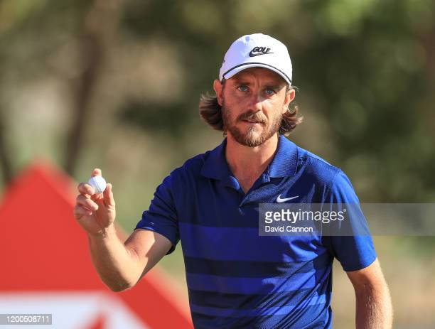 Tommy Fleetwood of England acknowledges the crowds after making a birdie putt on the 17th hole during the final round of the Abu Dhabi HSBC...