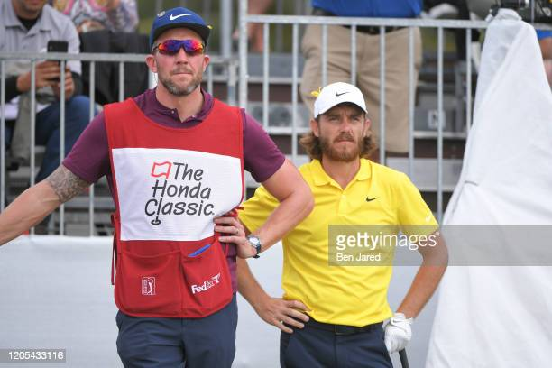 Tommy Fleetwood of England and his caddie stand together on the first tee during the final round of The Honda Classic at PGA National Champion course...
