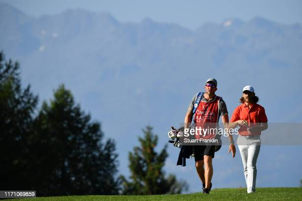 Tommy Fleetwood of England and his caddie walk down the 13th hole during Day Two of the Omega European Masters at CranssurSierre Golf Club on August...