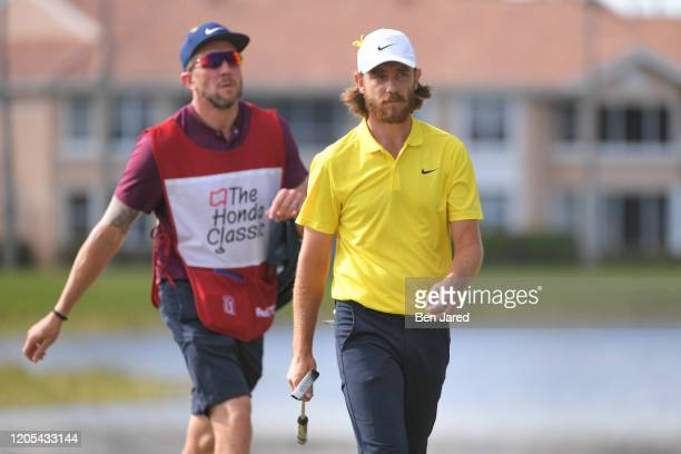 Tommy Fleetwood of England and his caddie walk off the eighth green during the final round of The Honda Classic at PGA National Champion course on...