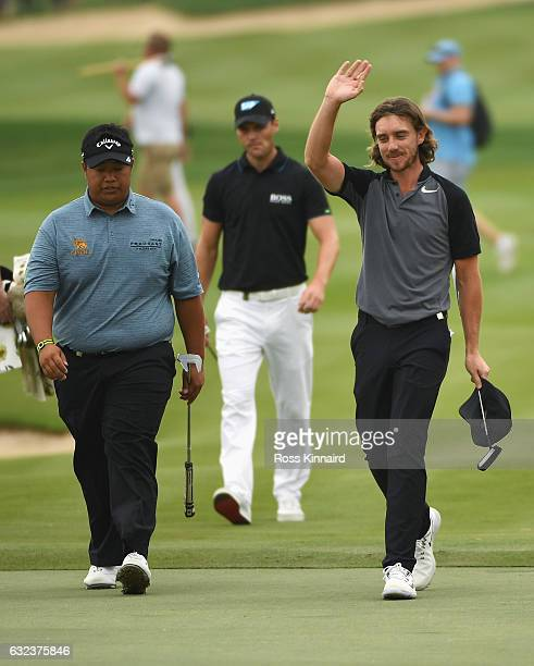 Tommy Fleetwood of England and Kiradech Aphibarnrat of Thailand walk to the 18th green during the final round of the Abu Dhabi HSBC Championship at...