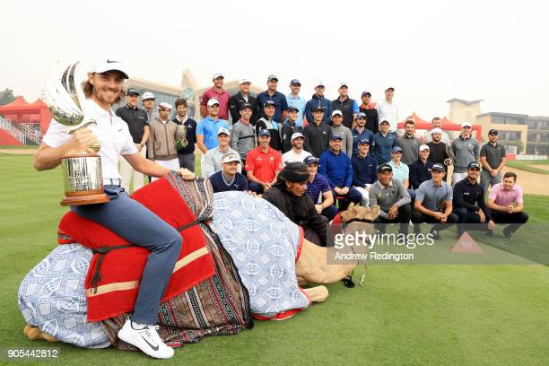 Tommy Fleetwood of England and other members of the European tour pose during a photocall for the Abu Dhabi HSBC Golf Championship at Abu Dhabi Golf...