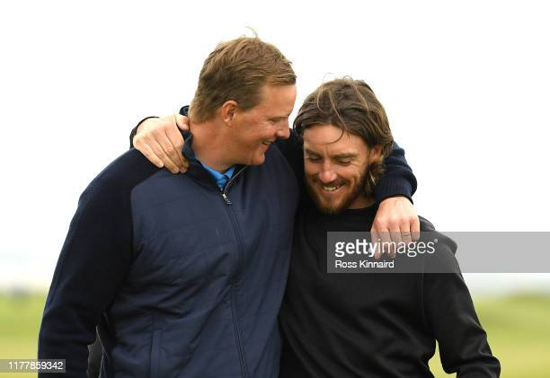 Tommy Fleetwood of England and playing partner Ogden Phipps celebrate finishing their round on the 9th hole during Day four of the Alfred Dunhill...