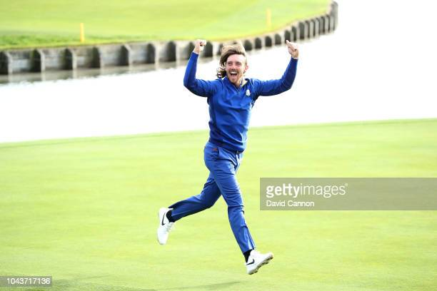 Tommy Fleetwood of England and the European Team runs onto the 18th green after Europe's 17.5-10.5 win over the United States during the singles...
