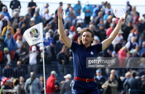 Tommy Fleetwood of England and the European Team waves to crowds after he had won his match with Francesco Molinari against Tiger Woods and Patrick...