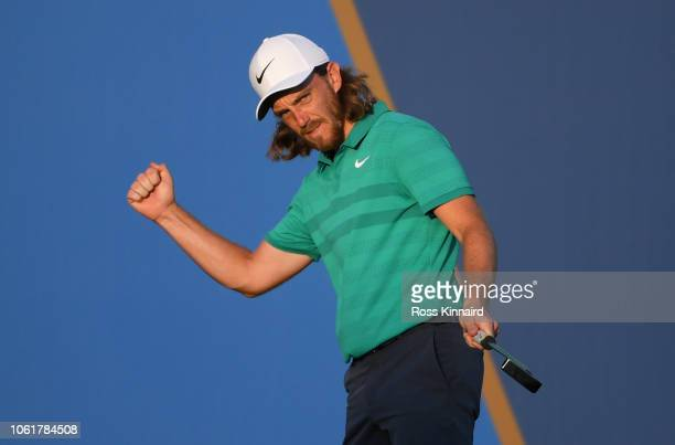 Tommy Fleetwood of England celebrates a birdie on the 18th green during day one of the DP World Tour Championship at Jumeirah Golf Estates on...
