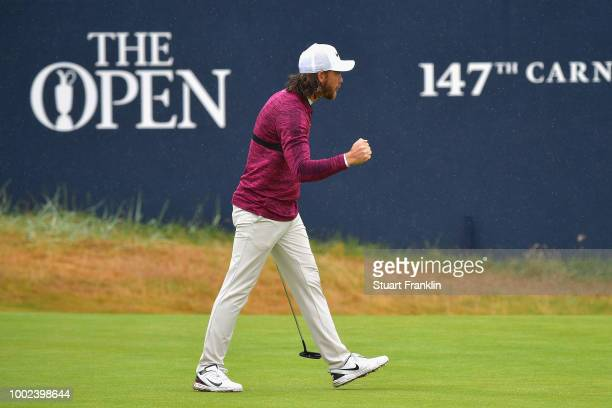 Tommy Fleetwood of England celebrates a birdie on the 18th green during the second round of the 147th Open Championship at Carnoustie Golf Club on...