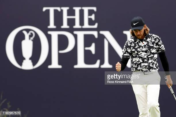 Tommy Fleetwood of England celebrates a birdie on the 18th green during the second round of the 148th Open Championship held on the Dunluce Links at...