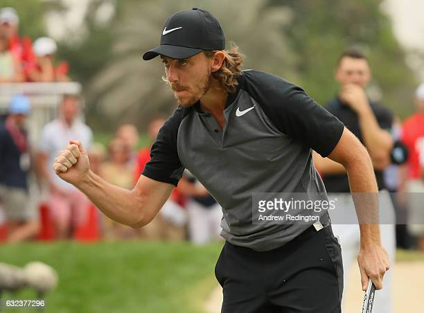 Tommy Fleetwood of England celebrates a birdie on the 18th hole during the final round of the Abu Dhabi HSBC Championship at Abu Dhabi Golf Club on...