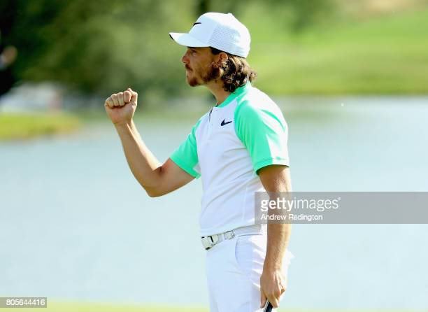 Tommy Fleetwood of England celebrates a par putt on the 18th green during day four of the HNA Open de France at Le Golf National on July 2, 2017 in...