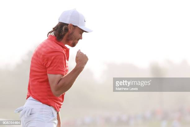 Tommy Fleetwood of England celebrates after putting for birdie on the 18th green to finish 22 under during the final round of the Abu Dhabi HSBC Golf...