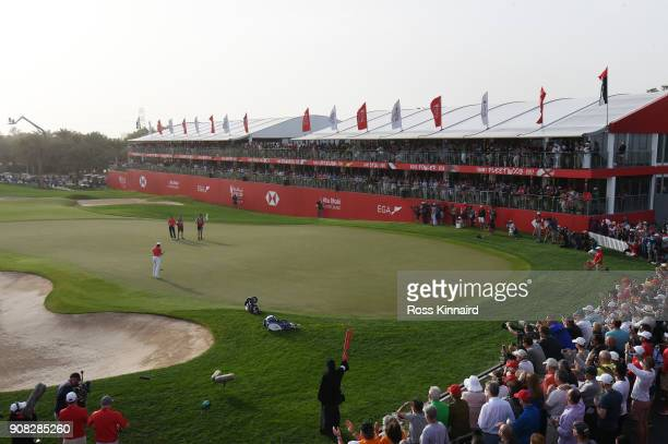 Tommy Fleetwood of England celebrates after putting for birdie on the 18th green to finish 22 under and win during the final round of the Abu Dhabi...