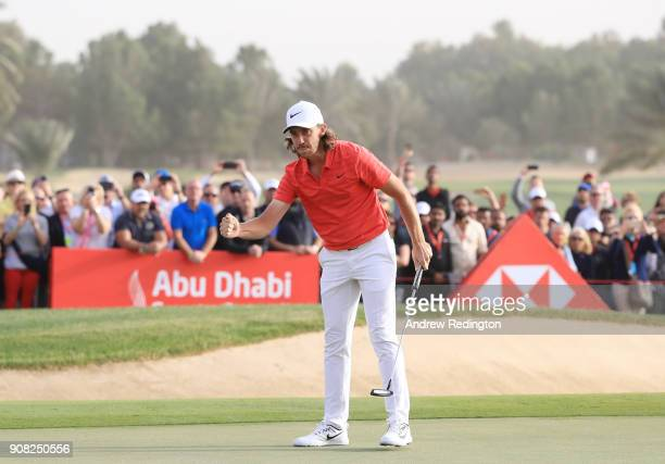 Tommy Fleetwood of England celebrates after putting for birdie to finish 22 under on the 18th green during the final round of the Abu Dhabi HSBC Golf...