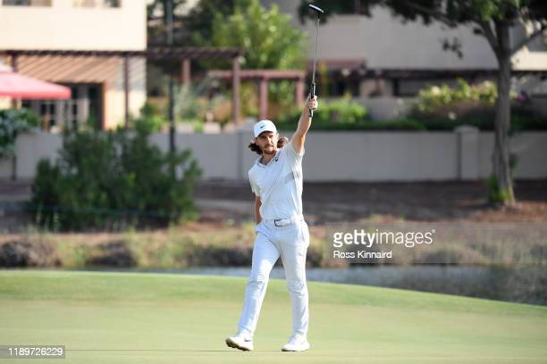 Tommy Fleetwood of England celebrates after putting in for a birdie on the seventeenth green during Day Four of the DP World Tour Championship Dubai...