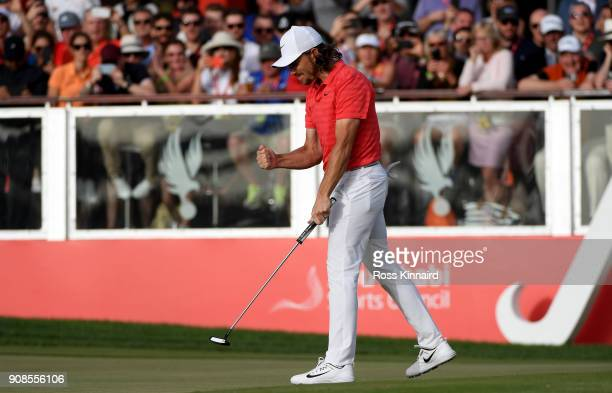 Tommy Fleetwood of England celebrates his birdie putt on the 18th green during the final round of the Abu Dhabi HSBC Golf Championship at Abu Dhabi...