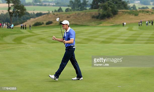 Tommy Fleetwood of England celebrates winning the Johnnie Walker Championship on the first extra hole in a three way play-off at Gleneagles on August...