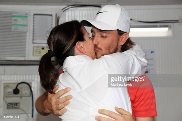 Tommy Fleetwood of England celebrates with his wife Clare Craig after winning during the final round of the Abu Dhabi HSBC Golf Championship at Abu...