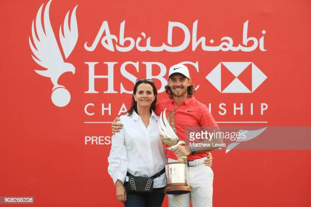 Tommy Fleetwood of England celebrates with his wife Clare Craig and the trophy after winning during the final round of the Abu Dhabi HSBC Golf...
